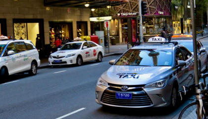 Taxi parked outside Hyde Park, Sydney