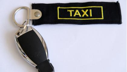 keys, taxi tag, white background
