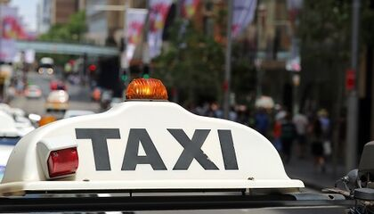 Image of the taxi sign on a vehicle